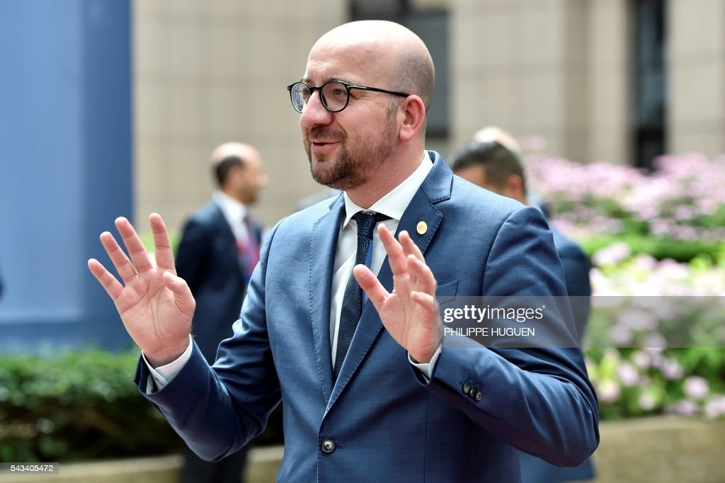 Belgium's Prime minister Charles Michel gestures to journalists as he arrives before an EU summit meeting on June 28, 2016 at the European Union headquarters in Brussels. / AFP / PHILIPPE
