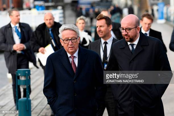 Belgium's Prime minister Charles Michel talks to European Commission President JeanClaude Juncker as they walk to the luncheon during the European...