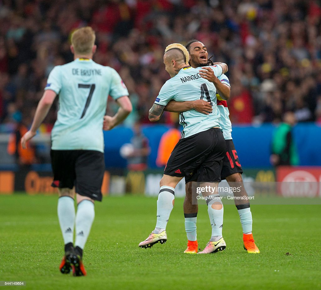 Belgium's <a gi-track='captionPersonalityLinkClicked' href=/galleries/search?phrase=Radja+Nainggolan&family=editorial&specificpeople=6339191 ng-click='$event.stopPropagation()'>Radja Nainggolan</a> celebrates scoring the opening goal with team mate <a gi-track='captionPersonalityLinkClicked' href=/galleries/search?phrase=Jason+Denayer&family=editorial&specificpeople=10953601 ng-click='$event.stopPropagation()'>Jason Denayer</a> during the UEFA Euro 2016 Quarter-final match between Wales and Belgium at Stade Pierre Mauroy on July 01 in Marseille, France.