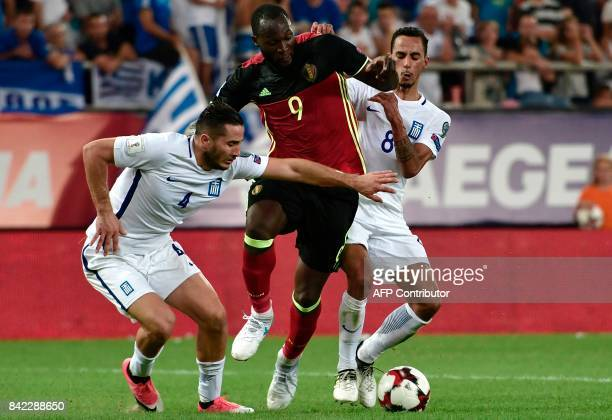 Belgium's Romelu Lukaku fights for the ball with Greece's Zeca and Konstantinos Manolas during their Group H 2018 FIFA World Cup qualifying football...