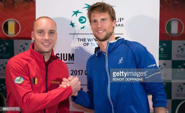 Belgium's Steve Darcis and Italy's Andreas Seppi shake hands as they pose during the draw ahead of the Davis Cup World Group quarterfinal between...