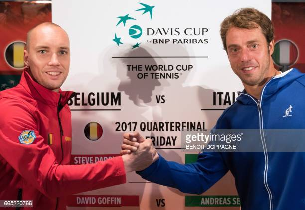 Belgium's Steve Darcis and Italy's Paolo Lorenzi shake hands as they pose during the draw ahead of the Davis Cup World Group quarterfinal between...