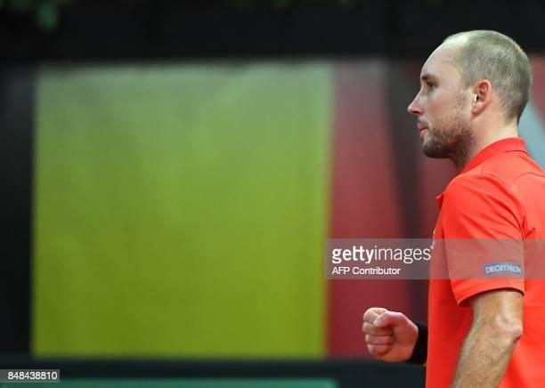 Belgium's Steve Darcis reacts after scoring against Australia's Jordan Thomson during the Davis Cup semifinal tennis match between Belgium and...