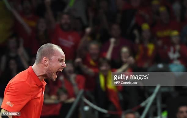 Belgium's Steve Darcis reacts during his tennis match against Australia's Jordan Thomson during the Davis Cup semifinal between Belgium and Australia...
