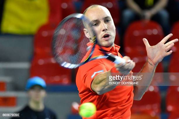 Belgium's Steve Darcis returns a ball to Italy's Paolo Lorenzi during the Davis Cup World Group quarterfinal tennis match between Belgium and Italy...