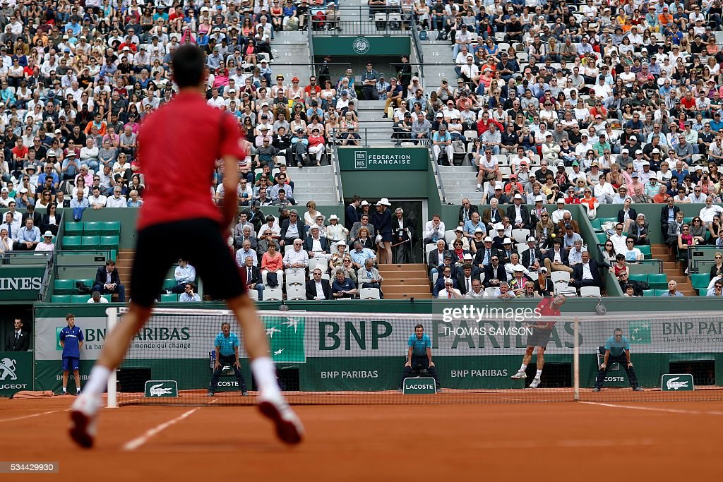Belgium's Steve Darcis returns the ball to Serbia's Novak Djokovic during his men's second round match at the Roland Garros 2016 French Tennis Open in Paris on May 26, 2016. / AFP / Thomas SAMSON