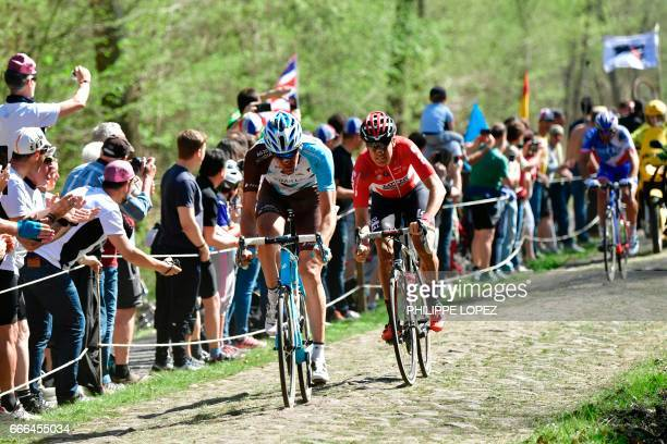 Belgium's Stijn Vandenbergh and Belgium's Jelle Wallays ride on the cobblestones in a breakaway during the 115th edition of the ParisRoubaix oneday...