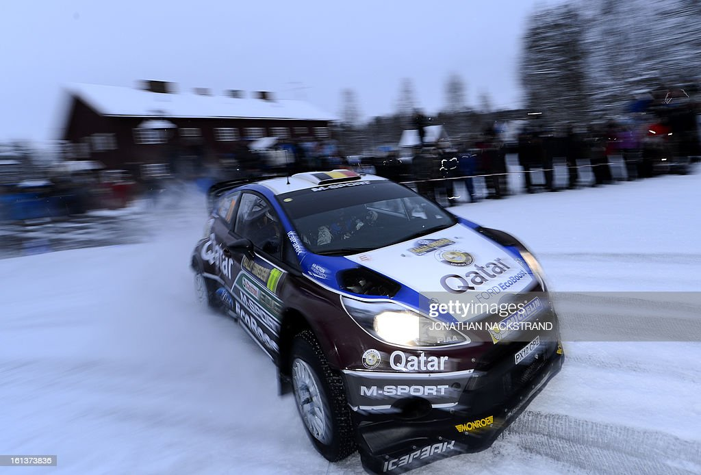 Belgium's Thierry Neuville and his co-driver Nicolas Gilsoul steer their Ford Fiesta RS WRC during Mitandersfors stage, the 17th of Rally Sweden, second round of the FIA World Rally Championship on February 10, 2013 on the border to Norway near Torsby, north of Karlstad, Sweden.