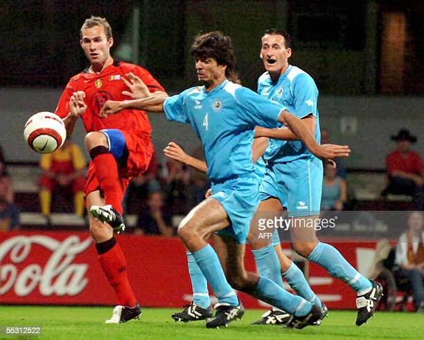 Belgium's Thomas Buffel chases San Marino's Frederico Crescentini during the UEFA World Cup group 7 qualifying match Belgium vs San Marino 07...