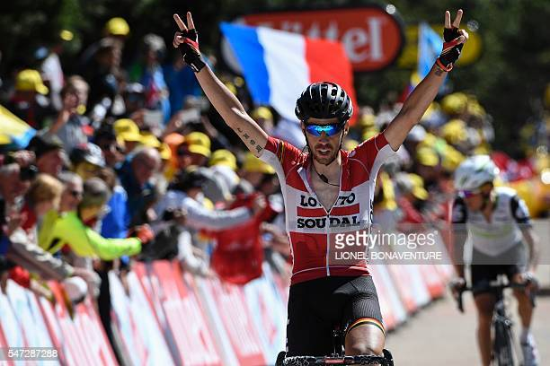 Belgium's Thomas De Gendt celebrates as he crosses the finish line of the 178 km twelvelth stage of the 103rd edition of the Tour de France cycling...