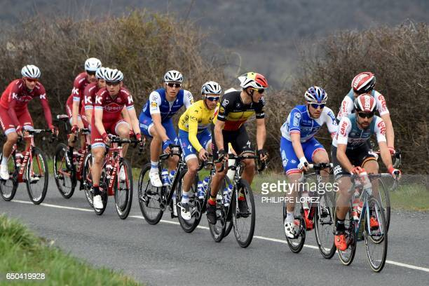 Belgium's Thomas De Gendt France's Rudy Molard Belgium's Philippe Gilbert France's Julian Alaphilippe wearing the overall leader's yellow jersey...