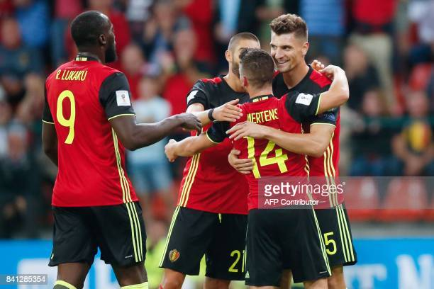 Belgium's Thomas Meunier celebrates with his teammates after scoring during the 2018 FIFA World Cup qualifying football match between Belgium and...