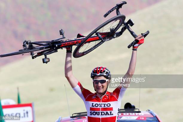 TOPSHOT Belgium's Tim Wellens of Lotto Soudal team holds his bike as he celebrates after winning the sixth stage a 157km ride from Ponte to Roccaraso...