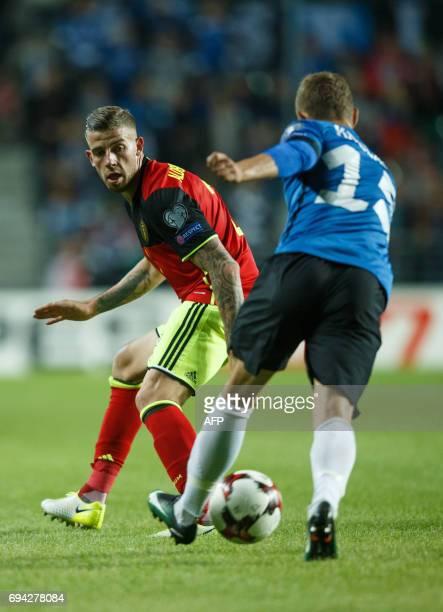 Belgium's Toby Alderweireld and Estonia's Ragnar Klavan vie for the ball during the FIFA World Cup 2018 qualification football match between Estonia...