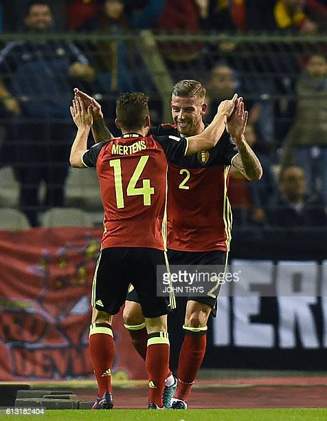 Belgium's Toby Alderweireld celebrates with Belgium's Dries Mertens after scoring during the Fifa WC 2018 football qualification match between...