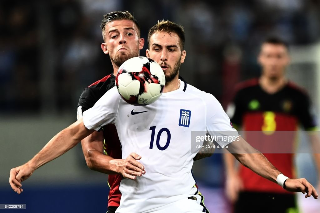 Belgium's Toby Alderweireld (L) fights for the ball with Greece's Kostas Fortounis during their Group H 2018 FIFA World Cup qualifying football match between Greece and Belgium at The Georgios Karaiskakis Stadium in Piraeus near Athens on September 3, 2017. /
