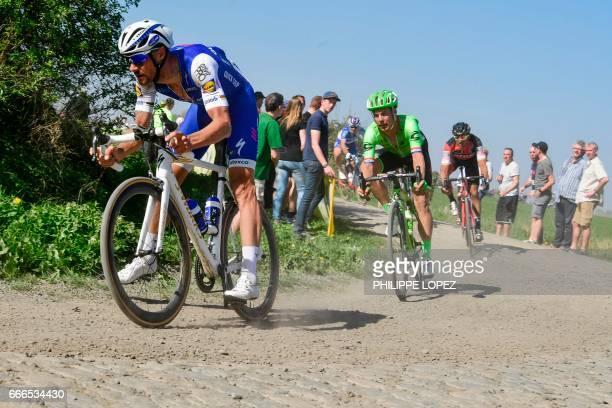 Belgium's Tom Boonen and Netherlands' Sebastian Langeveld ride on the cobblestones during the 115th edition of the ParisRoubaix oneday classic...