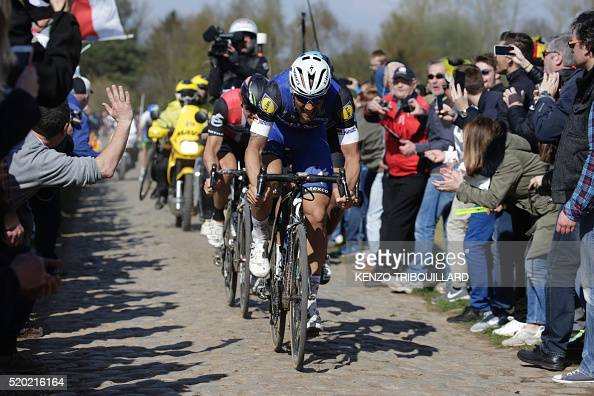 Belgium's Tom Boonen and Norway's Edvald Boasson Hagen ride on the cobblestones in a breakaway during the 114th edition of the ParisRoubaix oneday...