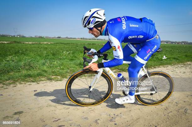 Belgium's Tom Boonen races during a track reconnaissance ahead of the 'ParisRoubaix' one day cycling race on April 7 2017 in Roubaix / AFP PHOTO /...