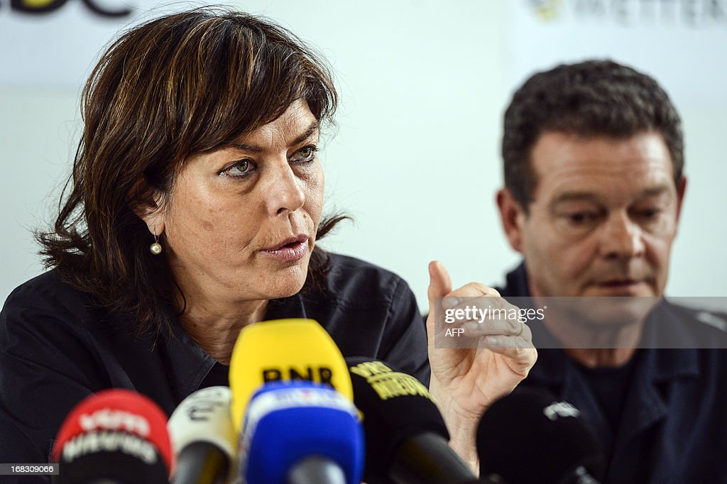 Belgium's Vice-Prime Minister and Interior Minister Joelle Milquet (L) gives a press conference beside chairman of the firefighting services Christian Van de Voorde in Wetteren on May 8, 2013. In the night of May 4 to 5 a freight train derailed and exploded on a track near Schellebelle, part of Wichelen, Wetteren. The train contained the chemical product acrylonitrile, a toxic and inflammable fluid that can cause breathing problems. Emergency services evacuated some 500 residents. One local resident died and 49 persons were brought to hospital. Belgium Out