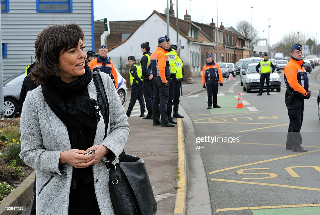 Belgium's Vice-Prime ministre and Interiro minister Joelle Milquet looks on as Belgian and a French police officers take part in a road traffic control on March 18, 2013 near the border in Tourcoing, northern France, as part of a Franco-Belgian cooperation agreement between police and customs.
