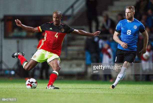 Belgium's Vincent Kompany and Estonia's Henri Anier vie for the ball during the FIFA World Cup 2018 qualification football match between Estonia and...