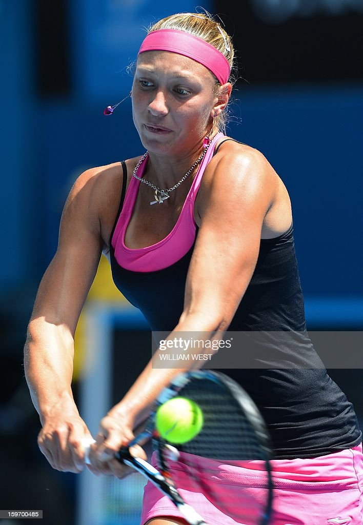 Belgium's Yanina Wickmayer hits a return against Russia's Maria Kirilenko during their women's singles match on day six of the Australian Open tennis tournament in Melbourne on January 19, 2013. AFP PHOTO / WILLIAM WEST IMAGE STRICTLY RESTRICTED TO EDITORIAL USE - STRICTLY NO COMMERCIAL USE