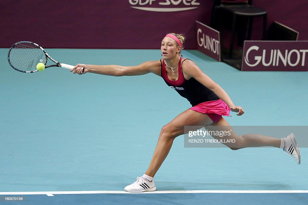 Belgium's Yanina Wickmayer returns the ball to Russia's Anastasia Pavlyuchenkova at the 21st edition of the Paris WTA Open on January 30, 2013. AFP PHOTO KENZO TRIBOUILLARD
