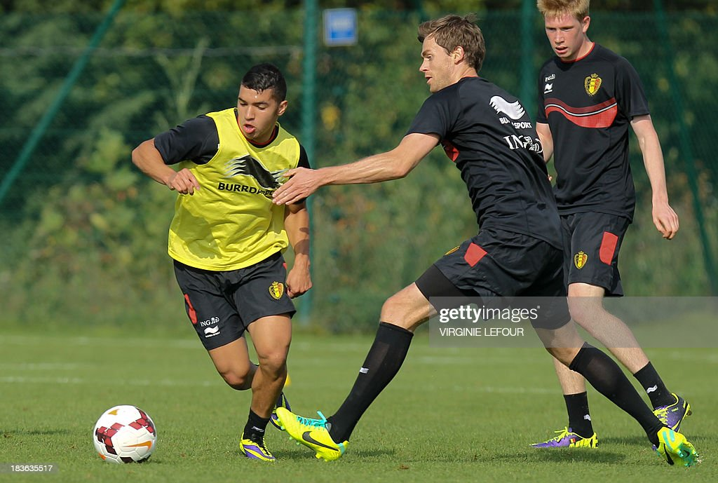 Belgium's Zakkari Bakkali and Nicolas Lombaerts take part in a training session of the Red Devils Belgian national football team in Neerpede, Brussels, on October 8, 2013 ahead of their qualification game against Croatia for the 2014 FIFA World Cup on October 11.