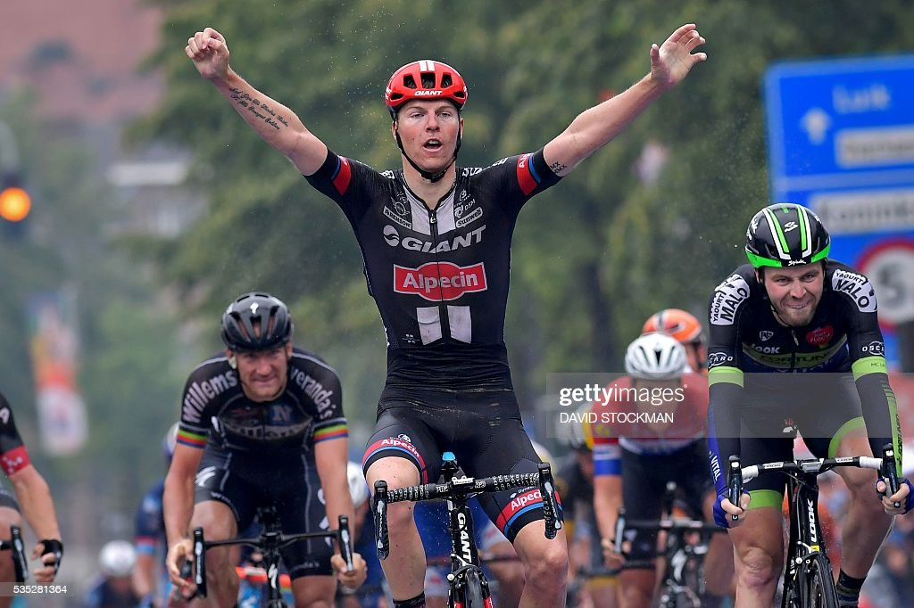 Belgium's Zico Waeytens of Team Giant-Alpecin (C) celebrates as he wins the finish of the final stage of the Baloise Belgium Tour cycling race, 174,2km from Tremelo to Tongeren, on May 29 2016 in Tongeren. / AFP / BELGA / DAVID STOCKMAN / Belgium OUT