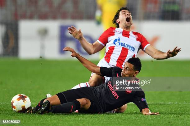 Belgrade's defender Filip Stojkovic vies with Arsenal's midfielder Francis Coquelin during the UEFA Europa League football between Belgrade and...