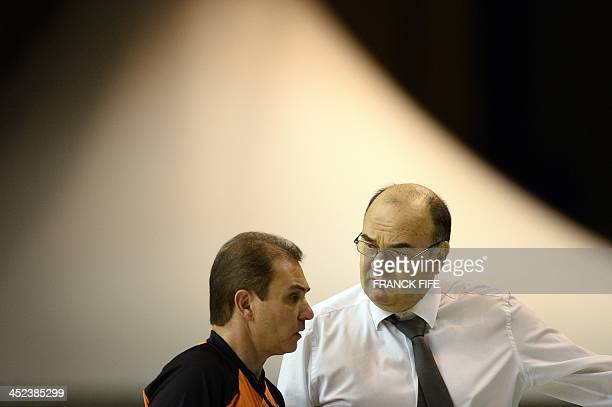 Belgrade's head coach Dusko Vujosevic speaks with a referee during the Euroleague basketball match Nanterre vs Partizan Belgrade on November 28 2013...