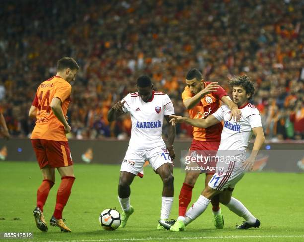 Belhanda of Galatasaray in action against Andre Poko of Kardemir Karabukspor during the Turkish Super Lig soccer match between Galatasaray and...