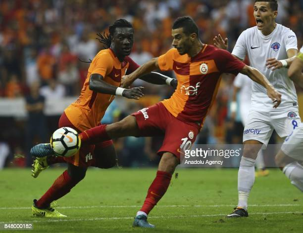 Belhanda of Galatasaray in action against David Pavelka of Kasimpasa during the fifth week of the Turkish Super Lig soccer match between Galatasaray...