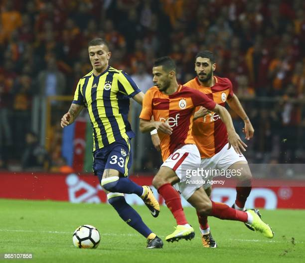 Belhanda of Galatasaray in action against Roman Neustadter of Fenerbahce during a Turkish Super Lig match between Galatasaray and Fenerbahce at Ali...