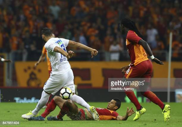 Belhanda of Galatasaray in action against Syam Youssef of Kasimpasa during the fifth week of Turkish Super Lig soccer match between Galatasaray and...