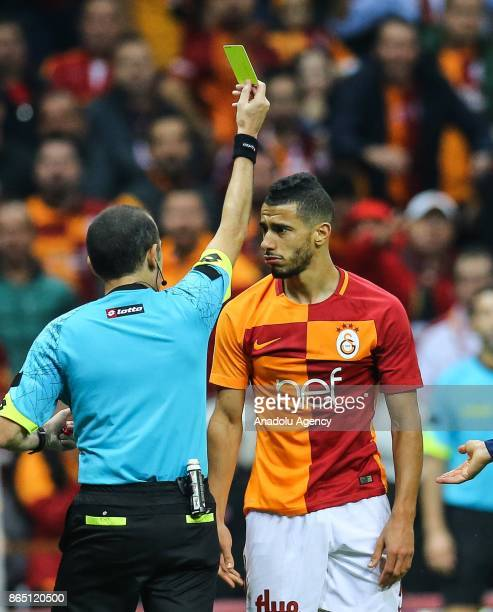 Belhanda of Galatasaray receives a red card after his second yellow card booking during a Turkish Super Lig match between Galatasaray and Fenerbahce...