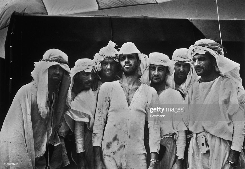 Believe it or not, these seedy looking 'Arabs' actually represent the cream of American manhood. They are the seven Mercury Astronauts, gathered for a group photo after completing rugged training at the U.S. Air Force Survival School at Stead Air Force Base in Nevada. Left to right are: <a gi-track='captionPersonalityLinkClicked' href=/galleries/search?phrase=Gordon+Cooper+-+Astronaut&family=editorial&specificpeople=90970 ng-click='$event.stopPropagation()'>Gordon Cooper</a>; <a gi-track='captionPersonalityLinkClicked' href=/galleries/search?phrase=Scott+Carpenter+-+Astronaut&family=editorial&specificpeople=92555 ng-click='$event.stopPropagation()'>Scott Carpenter</a>; John Glenn; Alan Shephard; Virgil Grissom; Walter Schirra; and Donald Slayton.