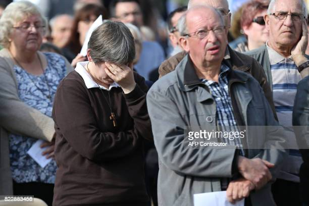 Believers attend a mass marking the first anniversary of the killing of French Catholic priest Jacques Hamel by two jihadists outside his church in...