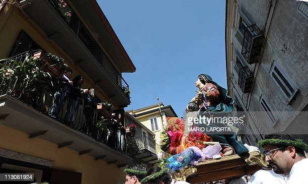 Believers carry a statue of Christ and the Virgin Mary during a procession on Holy Saturday on April 24 in Nocera Terinese in the Calabria region of...