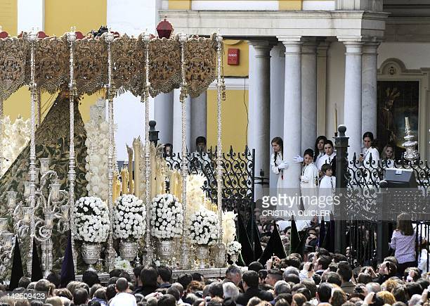 Believers gather around the Macarena Virgin during a Holy Week procession on April 6 2012 in Sevilla Christian believers around the world mark the...
