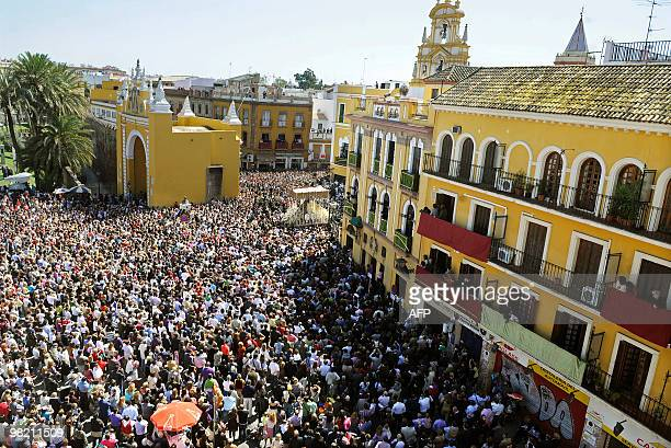 Believers take part in the 'La Macarena' brotherhood procession during the Holy Week in Sevilla on April 2 2010 Christian believers around the world...