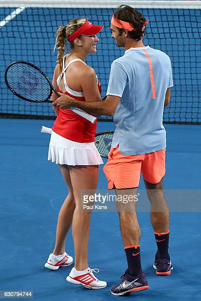 Belinda Bencic and Roger Federer of Switzerland celebrate winning the mixed doubles match against Heather Watson and Dan Evans of Great Britain on...