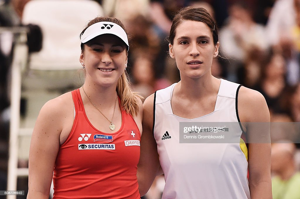 <a gi-track='captionPersonalityLinkClicked' href=/galleries/search?phrase=Belinda+Bencic&family=editorial&specificpeople=8837181 ng-click='$event.stopPropagation()'>Belinda Bencic</a> of Switzerland and <a gi-track='captionPersonalityLinkClicked' href=/galleries/search?phrase=Andrea+Petkovic&family=editorial&specificpeople=4253746 ng-click='$event.stopPropagation()'>Andrea Petkovic</a> of Germany pose prior to their match on Day 1 of the 2016 Fed Cup World Group First Round match between Germany and Switzerland at Messe Leipzig on February 6, 2016 in Leipzig, Germany.