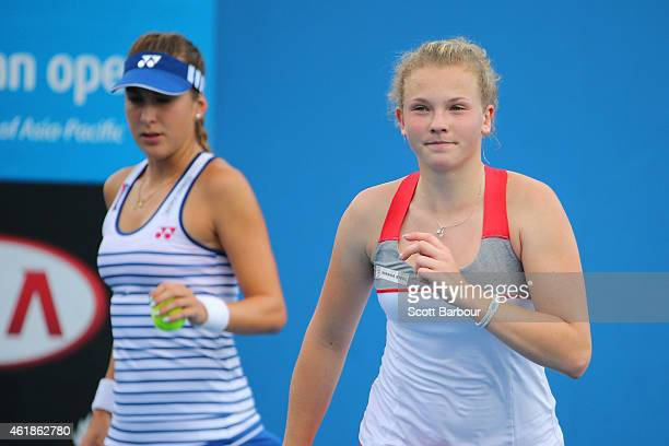 Belinda Bencic of Switzerland and Katerina Siniakova of the Czech Republic in action in their first round doubles match against Martina Hingis of...