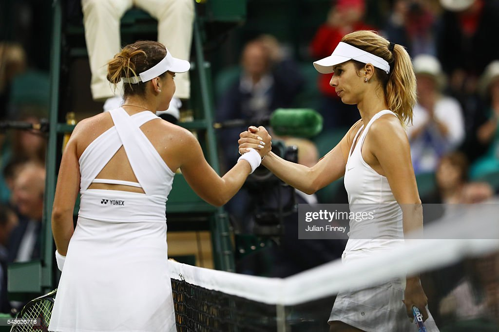 <a gi-track='captionPersonalityLinkClicked' href=/galleries/search?phrase=Belinda+Bencic&family=editorial&specificpeople=8837181 ng-click='$event.stopPropagation()'>Belinda Bencic</a> of Switzerland and <a gi-track='captionPersonalityLinkClicked' href=/galleries/search?phrase=Tsvetana+Pironkova&family=editorial&specificpeople=600804 ng-click='$event.stopPropagation()'>Tsvetana Pironkova</a> of Bulgaria shake hands following the Ladies Singles second round match on day three of the Wimbledon Lawn Tennis Championships at the All England Lawn Tennis and Croquet Club on June 29, 2016 in London, England.