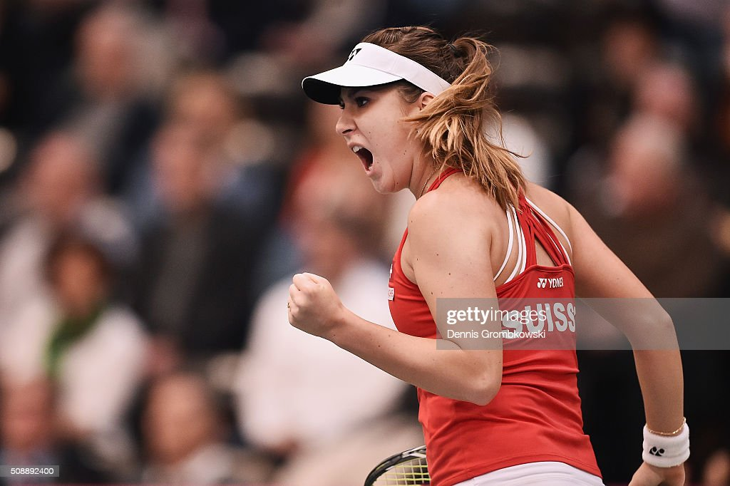 <a gi-track='captionPersonalityLinkClicked' href=/galleries/search?phrase=Belinda+Bencic&family=editorial&specificpeople=8837181 ng-click='$event.stopPropagation()'>Belinda Bencic</a> of Switzerland celebrates a point in her match against Angelique Kerber of Germany on Day 2 of the 2016 FedCup World Group Round 1 match between Germany and Switzerland at Messe Leipzig on February 7, 2016 in Leipzig, Germany.