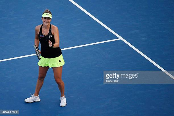 Belinda Bencic of Switzerland celebrates after defeating Angelique Kerber of Germany during Day 4 of the Western Southern Open at the Linder Family...