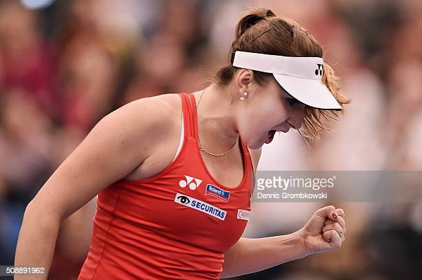 Belinda Bencic of Switzerland celebrates victory in her match against Angelique Kerber of Germany on Day 2 of the 2016 FedCup World Group Round 1...