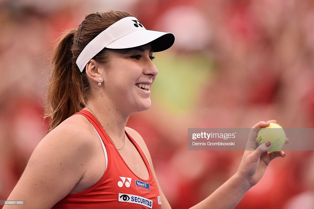 <a gi-track='captionPersonalityLinkClicked' href=/galleries/search?phrase=Belinda+Bencic&family=editorial&specificpeople=8837181 ng-click='$event.stopPropagation()'>Belinda Bencic</a> of Switzerland celebrates victory in her match against Angelique Kerber of Germany on Day 2 of the 2016 FedCup World Group Round 1 match between Germany and Switzerland at Messe Leipzig on February 7, 2016 in Leipzig, Germany.